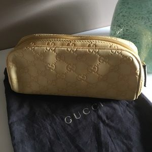 Gucci— Cosmetic case (Guccissima leather)